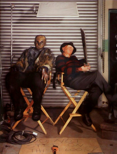 Jason and Freddy holding each other's junk.